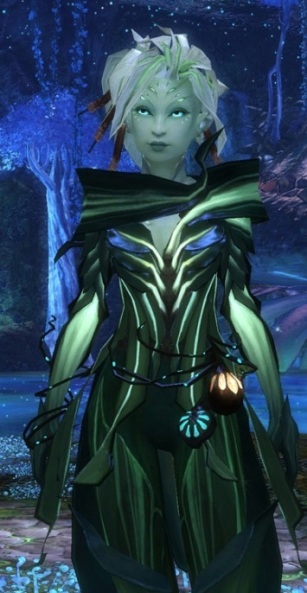 Green skinned, plant like woman from Guild Wars 2 wearing leafy clothing, with bedraggled, short white hair