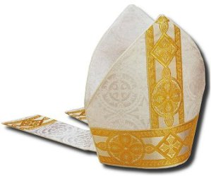 A bishop's mitre, white with elegant golden trim along its base and up its centre, with two tails aback.